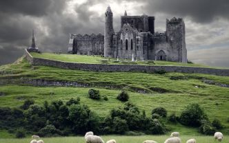 story-castle-ruins-and-field-with-sheep-stock-photo